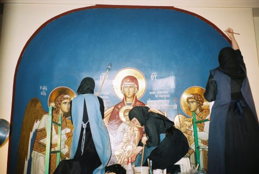 Nuns painting an icon